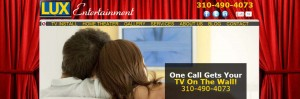 screen shot of lux-entertainment.com homepage header of couple on couch watching wall mount flat screnn TV